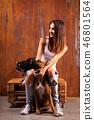 Beautiful woman with dog and raccoon 46801564