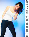 plus size woman in casual clothes posing in studio 46805429