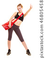 Sport. Fitness girl with gym bag showing thumb up 46805458