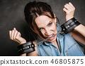 Arrest and jail. Criminal woman prisoner girl in handcuffs 46805875