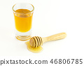 Honey with wooden isolated on a white background 46806785