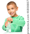 Boy with plastic bottle of water 46808807