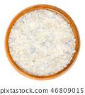 Persian Blue Fine Salt in wooden bowl over white 46809015