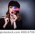 girl with shopping bags and flag of USA 46814706