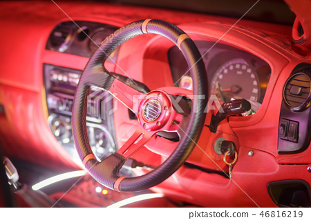 Red dashboard in vintage car 46816219
