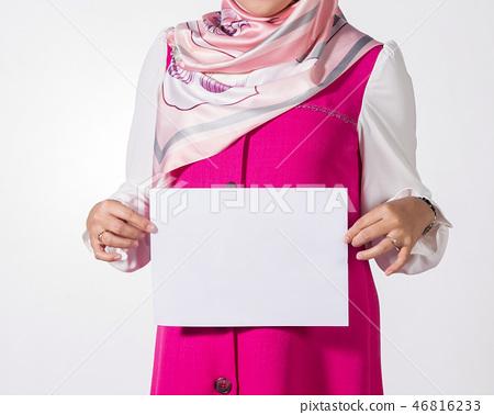 muslim woman showing  blank white paper. 46816233