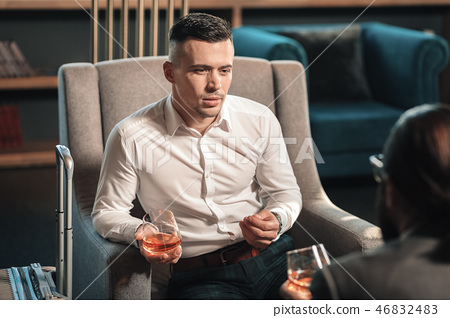 Young handsome promising lawyer drinking whisky with client 46832483