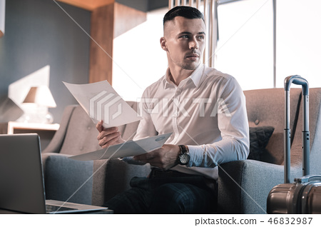 Rich investor waiting for his business partner sitting in hotel lobby 46832987