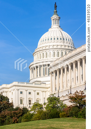 The United States Capitol building on a sunny day. 46839510