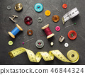sewing tools and accessories on slate stone 46844324