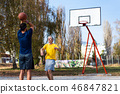 Father and son playing basketball in the park 46847821
