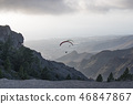 Two paragliders flying between mountains ridges in Tenerife 46847867