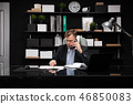 young man in business clothes working at computer Desk with phone and documents 46850083