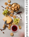 Cheese and grapes appetizer 46854109
