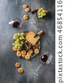 Cheese and grapes appetizer 46854116