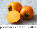 Whole and half of fresh ripe persimmons.  46855840