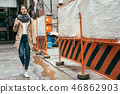 young girl pass through the under construction 46862903