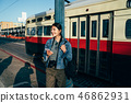 travel photographer get off from the light rail 46862931