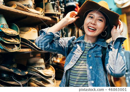 asian girl trying trilby in the cowboy shop 46863001