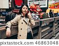 girl tourist standing near takoyaki restaurant 46863048