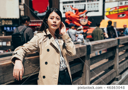 girl tourist standing near takoyaki restaurant 46863048