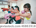 Sporty positive young women and man are boxing 46863918