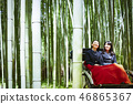 Two high school girls riding a rickshaw looking over Takebayashi 46865367