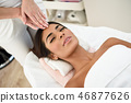 Woman receiving head massage in spa wellness center. 46877626
