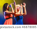 Two funny women in dresses with hands gesture. 46878085