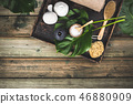 flat lay layout with monstera leaves and cosmetic care products 46880909