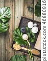 flat lay layout with monstera leaves and cosmetic care products 46880916