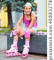 Little girl is wearing roller-blades 46883278