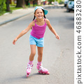 Happy little girl is skating on rollers 46883280