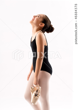 Happy young ballerina carrying her shoes 46884378