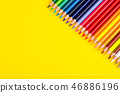 Set of colored pencils for schoolboy on bright 46886196