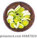 Plate with rings of chopped fresh leek 46887820
