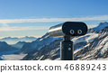 Public binocular on snow mountain peak 46889243