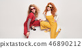 Two Gorgeous Girl in Fashion Outfit. Curly Hair 46890212