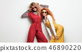 Two Gorgeous Girl in Fashion Outfit. Curly Hair 46890220