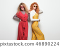 Two Gorgeous Girl in Fashion Outfit. Curly Hair 46890224