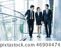 business partners walking down in office building  46904474