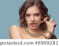 Beautiful young girl in studio with pearl jewelry - earrings, bracelet, necklace. 46909281