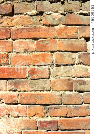 Vertical background of old brick wall 46909363