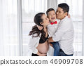 happy family concept, pregnant mother and father kissing boy 46909708