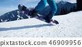 snowboarding jumping on slope in ski resort 46909956