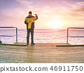 Tourist in wharf with smart phone in hand 46911750