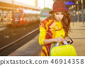 Pretty young woman at a train station (autumn toned image) 46914358