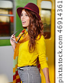 Pretty young woman at a train station (autumn toned image) 46914361