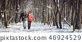Couple having a winter walk on a chilly cold day in the woods 46924529