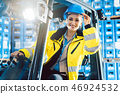 Woman driving a forklift in logistics delivery center 46924532